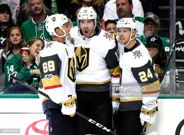 Nate Schmidt James Neal and Oscar Lindberg of the Vegas Golden Knights react after Neal scored a goal against the Dallas Stars during the season...