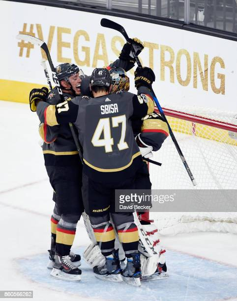 Nate Schmidt Luca Sbisa and MarcAndre Fleury of the Vegas Golden Knights celebrate after defeating the Arizona Coyotes in the Golden Knights'...