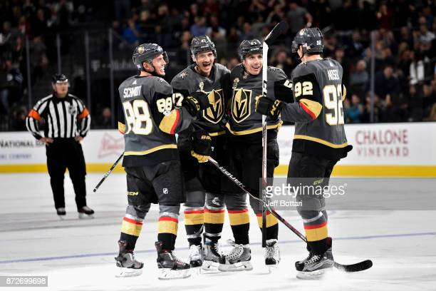 Nate Schmidt Luca Sbisa David Perron and Tomas Nosek of the Vegas Golden Knights celebrate after scoring a goal against the Winnipeg Jets during the...