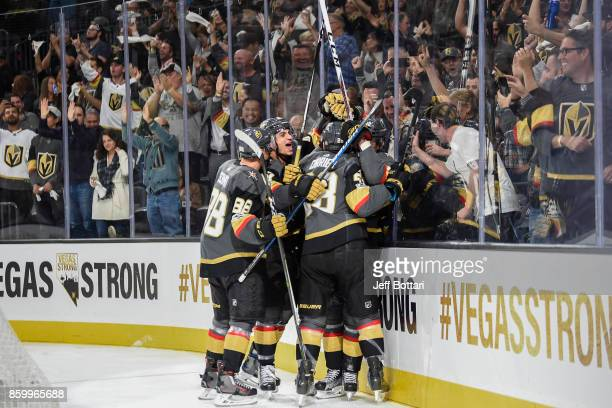 Nate Schmidt Luca Sbisa William Carrier and Tomas Nosek of the Vegas Golden Knights celebrate after scoring a goal during their inaugural...