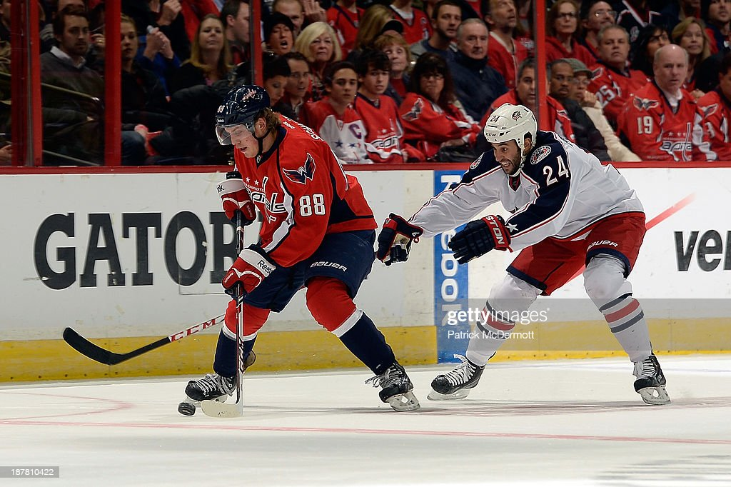 <a gi-track='captionPersonalityLinkClicked' href=/galleries/search?phrase=Nate+Schmidt&family=editorial&specificpeople=8280743 ng-click='$event.stopPropagation()'>Nate Schmidt</a> #88 of the Washington Capitals battles for the puck against <a gi-track='captionPersonalityLinkClicked' href=/galleries/search?phrase=Derek+MacKenzie&family=editorial&specificpeople=685877 ng-click='$event.stopPropagation()'>Derek MacKenzie</a> #24 of the Columbus Blue Jackets in the third period during an NHL game at Verizon Center on November 12, 2013 in Washington, DC.