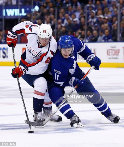 Nate Schmidt of the Washington Capitals battles with Zach Hyman of the Toronto Maple Leafs during the second period in Game Four of the Eastern...