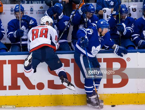 Nate Schmidt of the Washington Capitals misses a check against Leo Komarov of the Toronto Maple Leafs during the first period in Game Four of the...