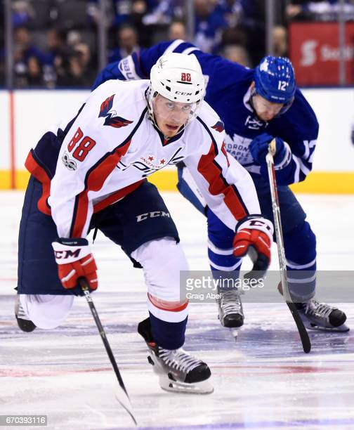 Nate Schmidt of the Washington Capitals skates against Connor Brown of the Toronto Maple Leafs during the first period in Game Four of the Eastern...