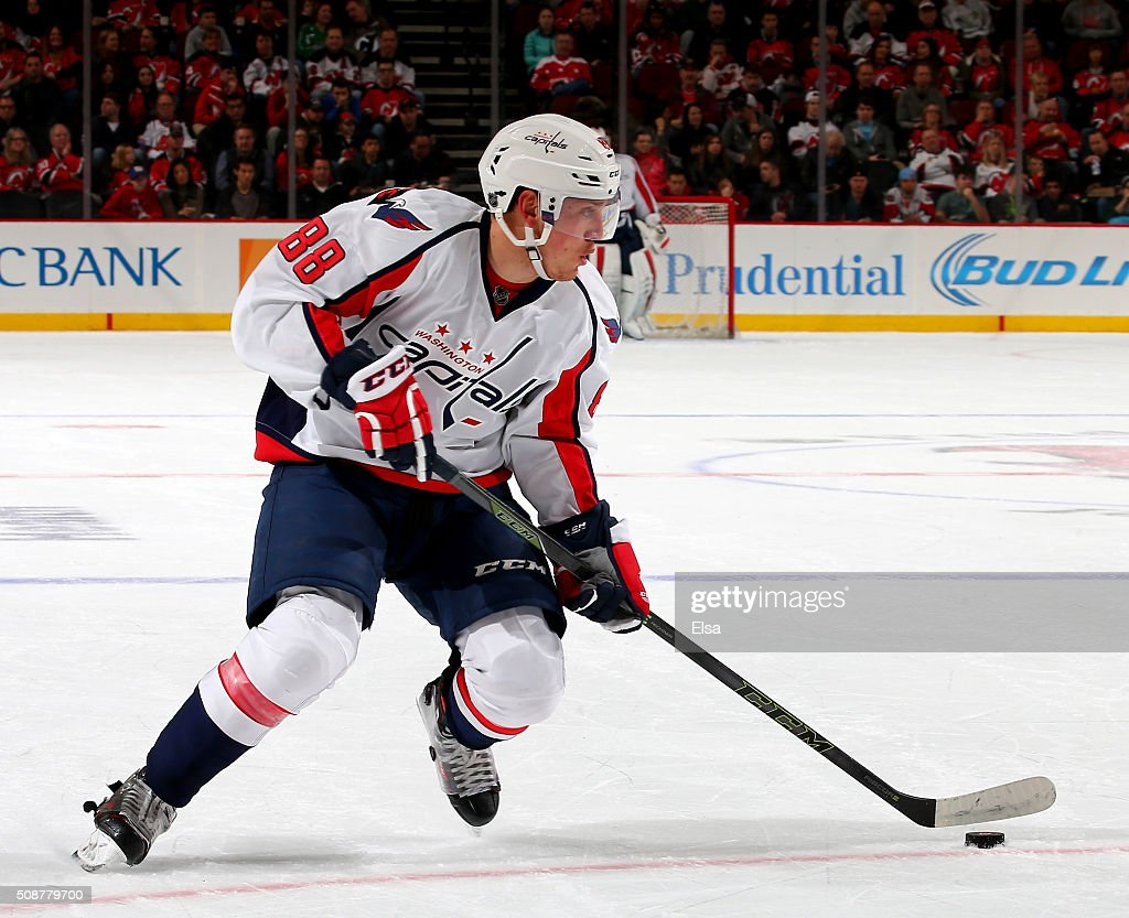 <a gi-track='captionPersonalityLinkClicked' href=/galleries/search?phrase=Nate+Schmidt&family=editorial&specificpeople=8280743 ng-click='$event.stopPropagation()'>Nate Schmidt</a> #88 of the Washington Capitals takes the puck in the first perido against the New Jersey Devils on February 6, 2016 at Prudential Center in Newark, New Jersey.