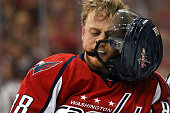 Nate Schmidt of the Washington Capitals tries to get his helmet adjusted after a scrum between teammates and Pittsburgh Penguins players during the...