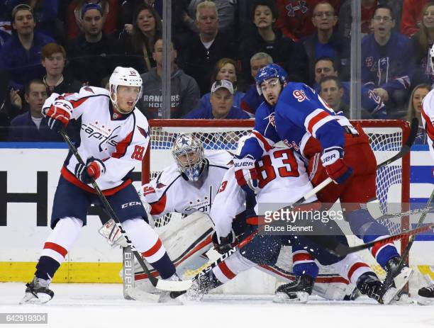 Nate Schmidt Philipp Grubauer and Jay Beagle of the Washington Capitals defend against Mika Zibanejad of the New York Rangers during the first period...