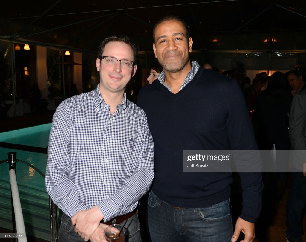 Nate Silver (L) and BuzzFeed West Coast vice president of sales Terry City attend BuzzFeed's Los Angeles Bureau Party at SkyBar at the Mondrian Los Angeles on November 29, 2012 in West Hollywood, California.