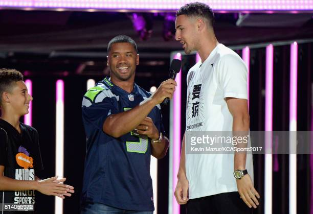 Nate Simon host Russell Wilson and NBA player Klay Thompson participate in a challenge during Nickelodeon Kids' Choice Sports Awards 2017 at Pauley...