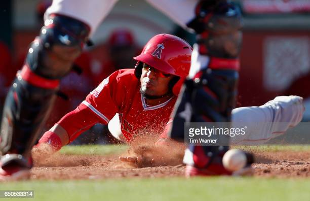Nate Smith of the Los Angeles Angels of Anaheim scores in the ninth inning against the Cleveland Indians during the spring training game at Goodyear...