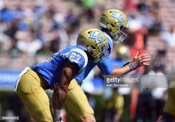 Nate Starks and UCLA Josh Rosen wait for the snap during a college football game between the Hawai'i Rainbow Warriors and the UCLA Bruins on...