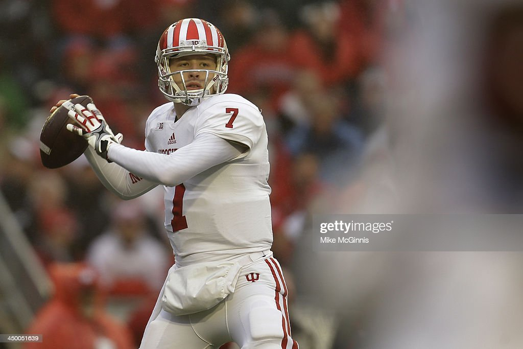 Nate Sudfeld #7 of the Indiana Hoosiers drops back to pass the football in the first half of play against the Wisconsin Badgers at Camp Randall Stadium on November 16, 2013 in Madison, Wisconsin.