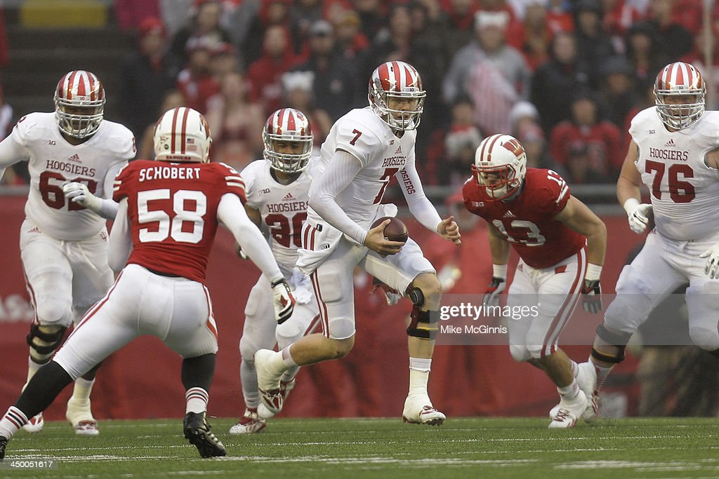 Nate Sudfeld #7 of the Indiana Hoosiers runs with the football during the first half of play against the Wisconsin Badgers at Camp Randall Stadium on November 16, 2013 in Madison, Wisconsin.