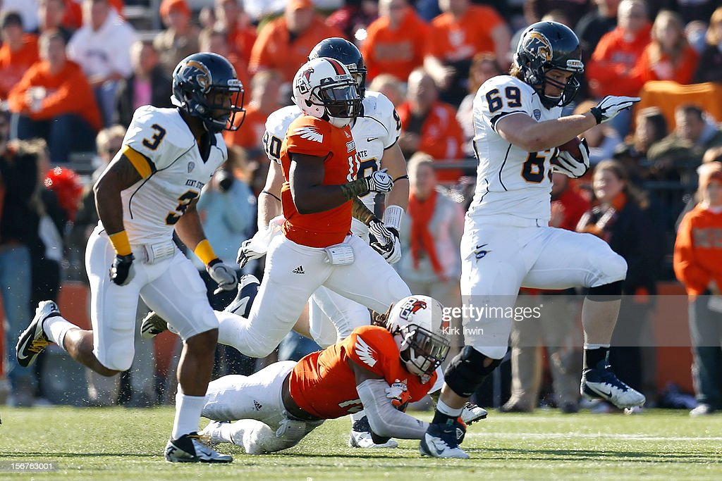 Nate Terhune of the Kent State Golden Flashes rushes for a first down on a fake punt during the game against the Bowling Green Falcons on November 17...