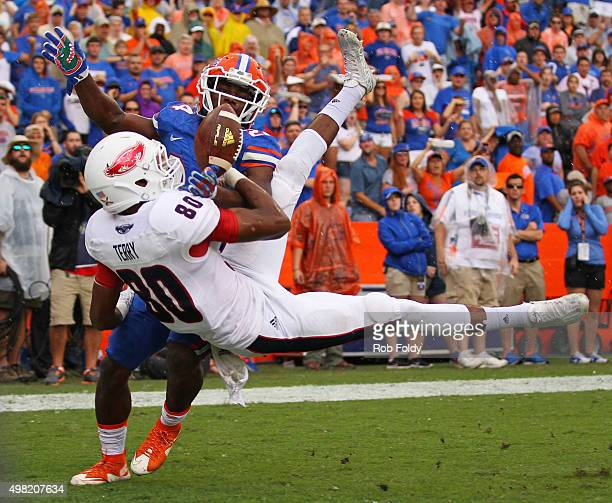 Nate Terry of the Florida Atlantic Owls has a pass broken up by Brian Poole of the Florida Gators in the end zone during overtime in the game at Ben...