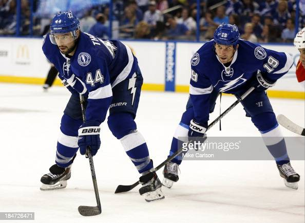 Nate Thompson and BJ Crombeen of the Tampa Bay Lightning play the Florida Panthers at the Tampa Bay Times Forum on October 10 2013 in Tampa Florida