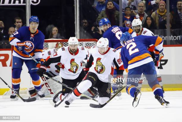 Nate Thompson and Matt Duchene of the Ottawa Senators look to block a shot in the final minute of their 65 victory over the New York Islanders at the...