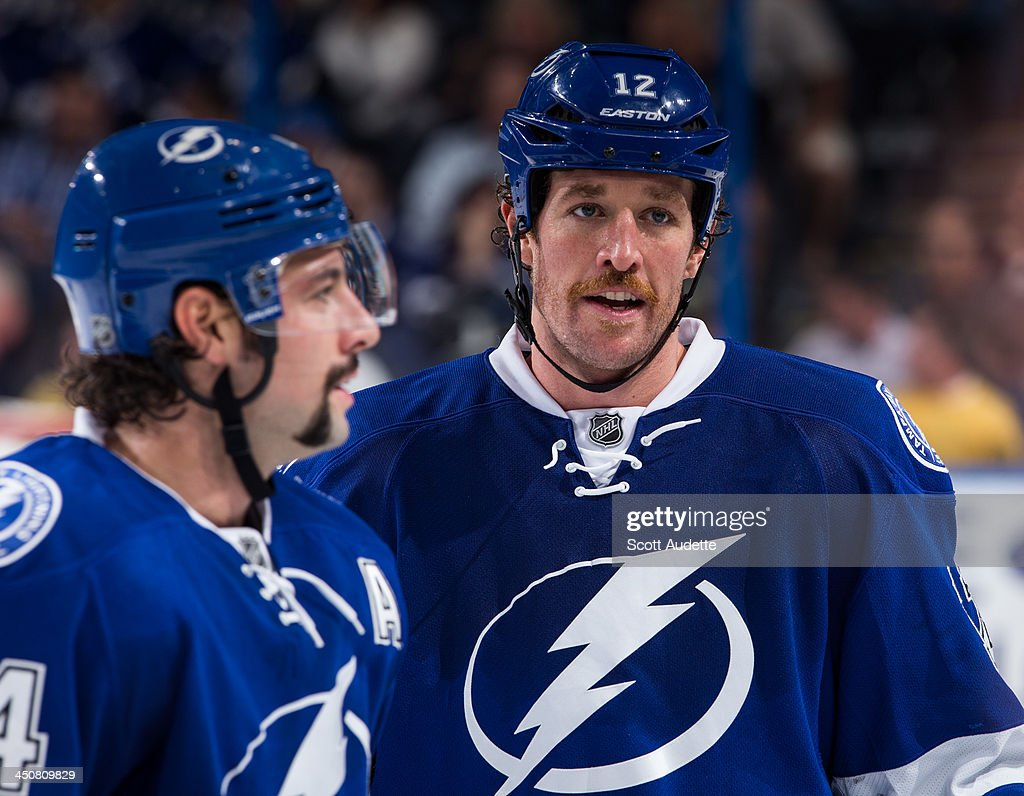 Nate Thompson and Ryan Malone of the Tampa Bay Lightning joke during a break against the Anaheim Ducks at the Tampa Bay Times Forum on November 14...
