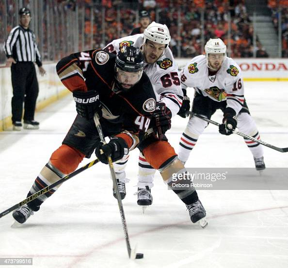 Nate Thompson of the Anaheim Ducks and Andrew Shaw of the Chicago Blackhawks skate in Game One of the Western Conference Finals during the 2015 NHL...