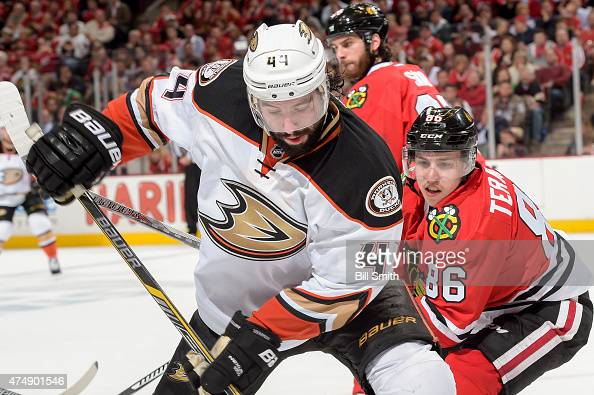 Nate Thompson of the Anaheim Ducks and Teuvo Teravainen of the Chicago Blackhawks chase the puck in Game Six of the Western Conference Finals during...