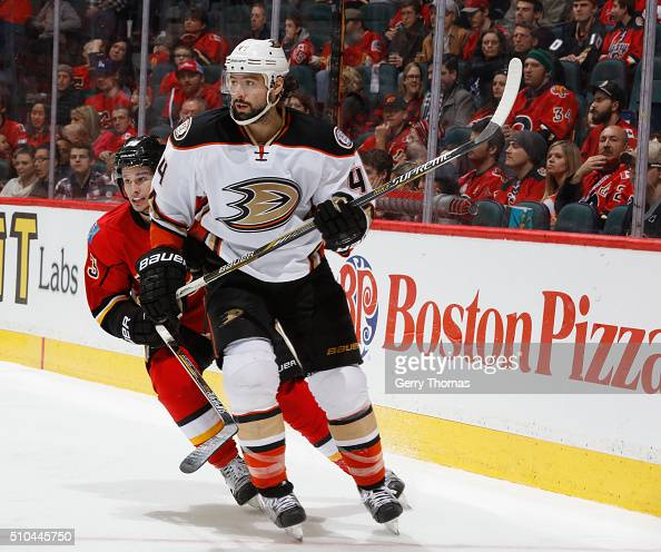 Nate Thompson of the Anaheim Ducks battles against Sean Monahan of the Calgary Flames at Scotiabank Saddledome on February 15 2016 in Calgary Alberta...