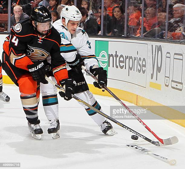 Nate Thompson of the Anaheim Ducks battles for the puck against Micheal Haley of the San Jose Sharks on December 4 2015 at Honda Center in Anaheim...
