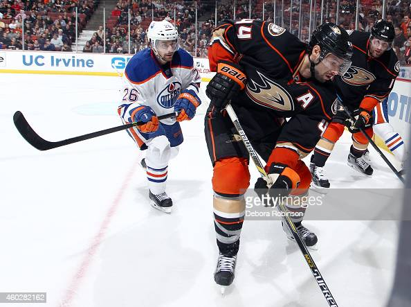 Nate Thompson of the Anaheim Ducks handles the puck against Mark Arcobello of the Edmonton Oilers on December 10 2014 at Honda Center in Anaheim...
