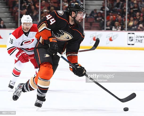 Nate Thompson of the Anaheim Ducks handles the puck against the Carolina Hurricanes on February 3 2015 at Honda Center in Anaheim California