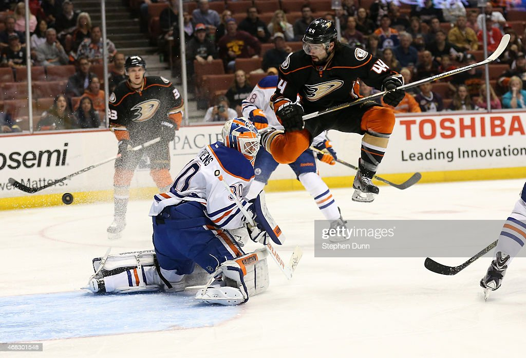 <a gi-track='captionPersonalityLinkClicked' href=/galleries/search?phrase=Nate+Thompson+-+Ice+Hockey+Player&family=editorial&specificpeople=7419417 ng-click='$event.stopPropagation()'>Nate Thompson</a> #4 of the Anaheim Ducks jumps in the air as a shot by Duck Francois Beauchemin #23 gets by goalie <a gi-track='captionPersonalityLinkClicked' href=/galleries/search?phrase=Ben+Scrivens&family=editorial&specificpeople=7185205 ng-click='$event.stopPropagation()'>Ben Scrivens</a> #32 of the Edmonton Oilers for a first period goal at Honda Center on April 1, 2015 in Anaheim, California.