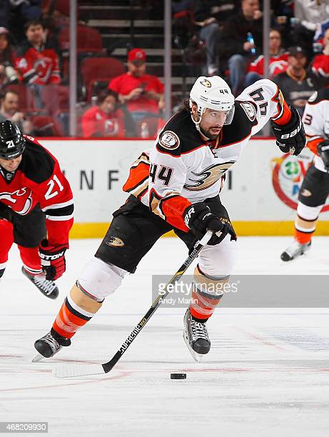 Nate Thompson of the Anaheim Ducks plays the puck against the New Jersey Devils during the game at the Prudential Center on March 29 2015 in Newark...