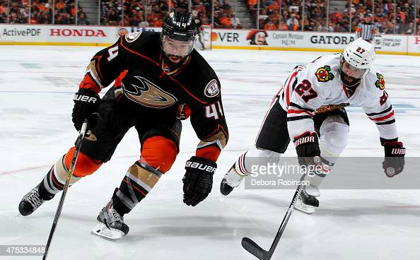 Nate Thompson of the Anaheim Ducks skates against Johnny Oduya of the Chicago Blackhawks in Game Seven of the Western Conference Finals during the...