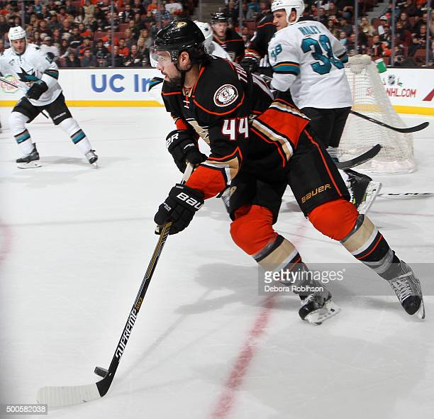 Nate Thompson of the Anaheim Ducks skates with the puck against the San Jose Sharks on December 4 2015 at Honda Center in Anaheim California