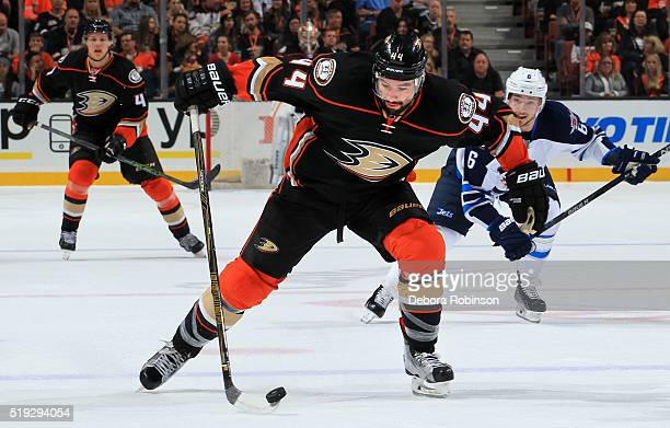 Nate Thompson of the Anaheim Ducks skates with the puck as Alexander Burmistrov of the Winnipeg Jets back checks on April 5 2016 at Honda Center in...