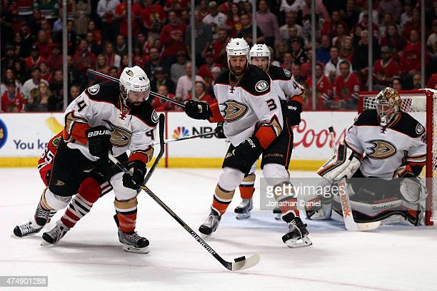 Nate Thompson of the Anaheim Ducks tries to clear the puck against the Chicago Blackhawks in Game Six of the Western Conference Finals during the...