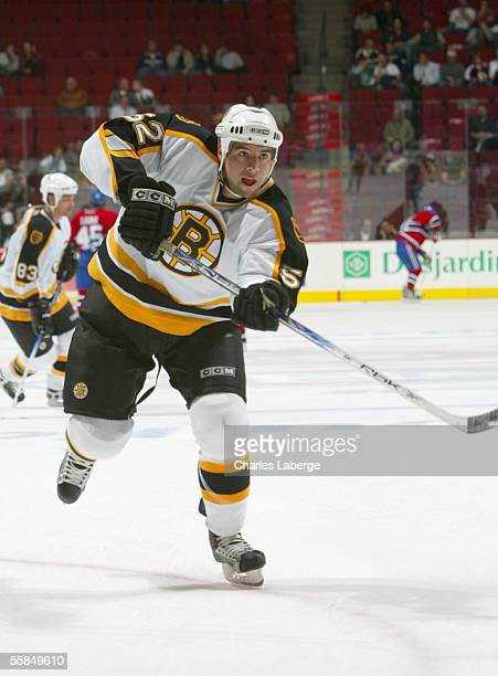 Nate Thompson of the Boston Bruins moves the puck during the game against the Montreal Canadiens during a preseason game on September 27 2005 at the...