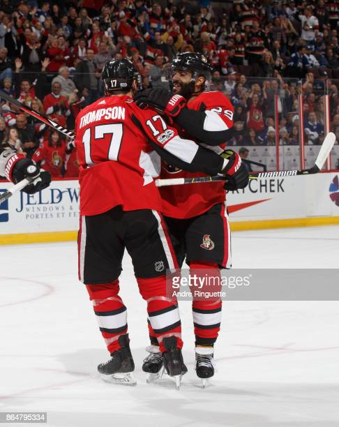 Nate Thompson of the Ottawa Senators celebrates his first period goal against the Toronto Maple Leafs with teammate Johnny Oduya at Canadian Tire...