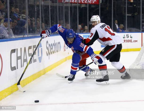 Nate Thompson of the Ottawa Senators checks Marc Staal of the New York Rangers at Madison Square Garden on November 19 2017 in New York City