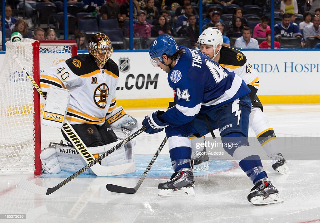 Nate Thompson #44 of the Tampa Bay Lightning battles against <a gi-track='captionPersonalityLinkClicked' href=/galleries/search?phrase=Dennis+Seidenberg&family=editorial&specificpeople=204616 ng-click='$event.stopPropagation()'>Dennis Seidenberg</a> #44 of the Boston Bruins in front of goalie <a gi-track='captionPersonalityLinkClicked' href=/galleries/search?phrase=Tuukka+Rask&family=editorial&specificpeople=716723 ng-click='$event.stopPropagation()'>Tuukka Rask</a> #40 during the third period at the Tampa Bay Times Forum on October 19, 2013 in Tampa, Florida.