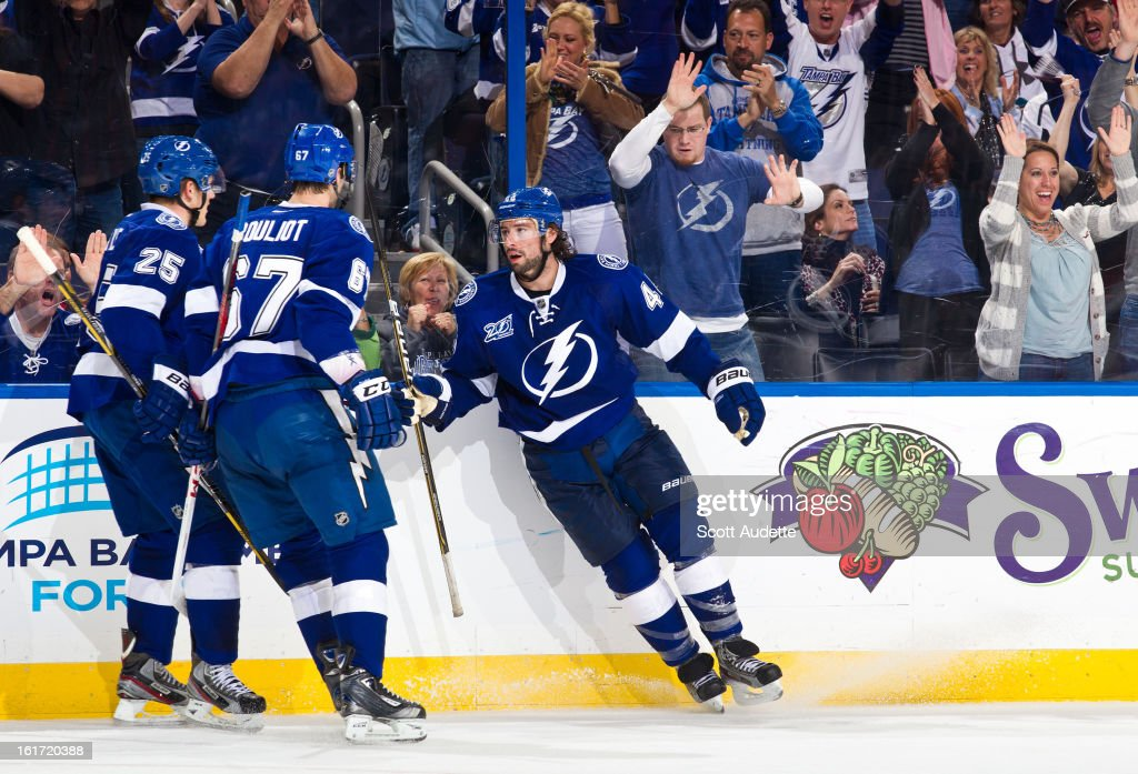Nate Thompson #44 of the Tampa Bay Lightning celebrates after scoring the Lightning's third goal during the third period of the game against the Washington Capitals at the Tampa Bay Times Forum on February 14, 2013 in Tampa, Florida.