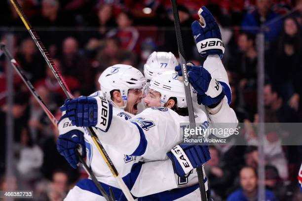 Nate Thompson of the Tampa Bay Lightning celebrates his game winning goal in overtime with teammtes during the NHL game against the Montreal...