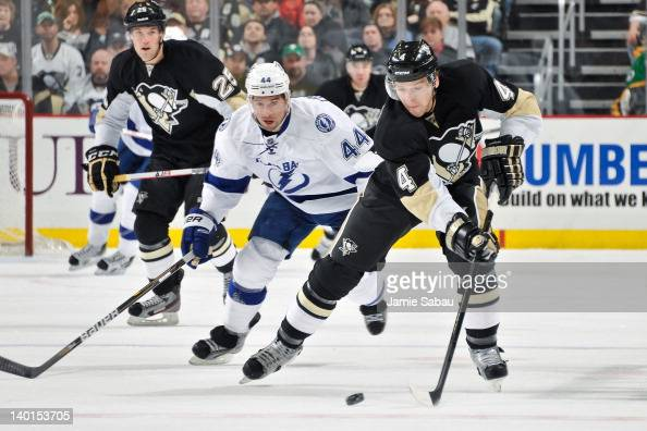 Nate Thompson of the Tampa Bay Lightning defends against Zbynek Michalek of the Pittsburgh Penguins on February 25 2012 at CONSOL Energy Center in...