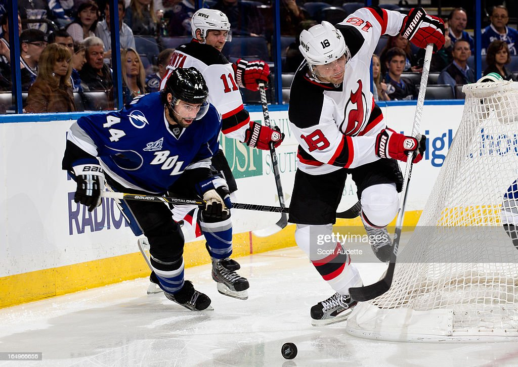 Nate Thompson #44 of the Tampa Bay Lightning fights for position and control of the puck with <a gi-track='captionPersonalityLinkClicked' href=/galleries/search?phrase=Steve+Bernier&family=editorial&specificpeople=557040 ng-click='$event.stopPropagation()'>Steve Bernier</a> #18 of the New Jersey Devils during the second period of the game at the Tampa Bay Times Forum on March 29, 2013 in Tampa, Florida. The second period wrapped up with a tie game, 2-2.