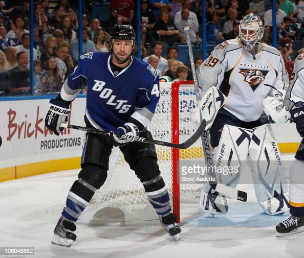 Nate Thompson of the Tampa Bay Lightning sets up in front of goaltender Anders Lindback of the Nashville Predators at the St Pete Times Forum on...
