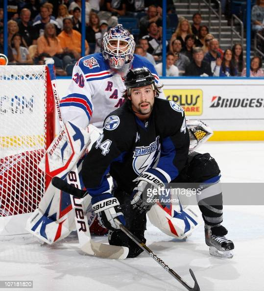 Nate Thompson of the Tampa Bay Lightning sets up in front of the net against goaltender Henrik Lundqvist of the New York Rangers at the St Pete Times...