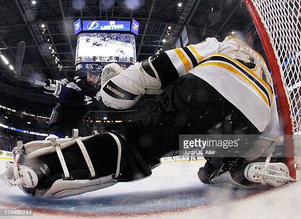 Nate Thompson of the Tampa Bay Lightning shoots against Tim Thomas of the Boston Bruins in Game Four of the Eastern Conference Finals during the 2011...