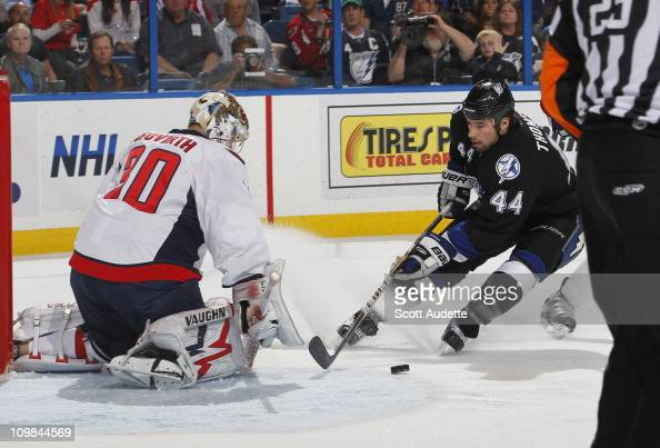 Nate Thompson of the Tampa Bay Lightning shoots the puck on goaltender Michal Neuvirth of the Washington Capitals during the first period at the St...