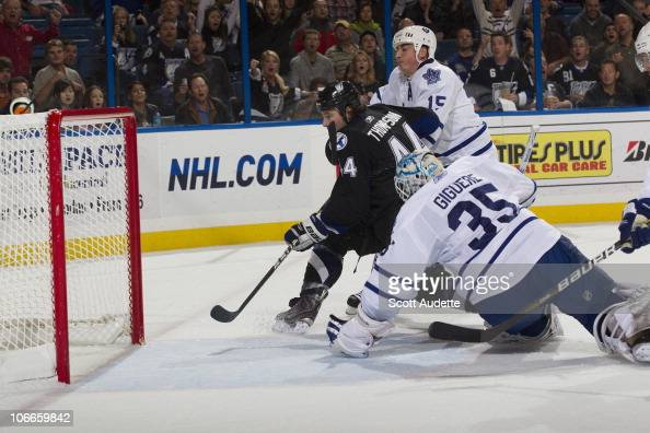 Nate Thompson of the Tampa Bay Lightning shoots the puck past goaltender JeanSebastien Giguere of the Toronto Maple Leafs in the first period at the...