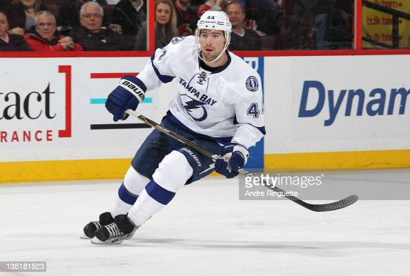 Nate Thompson of the Tampa Bay Lightning skates against the Ottawa Senators at Scotiabank Place on December 5 2011 in Ottawa Ontario Canada