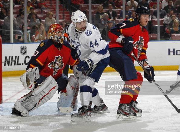 Nate Thompson of the Tampa Bay Lightning takes up a position in front of goaltender Jose Theodore of the Florida Panthers on November 25 2011 at the...