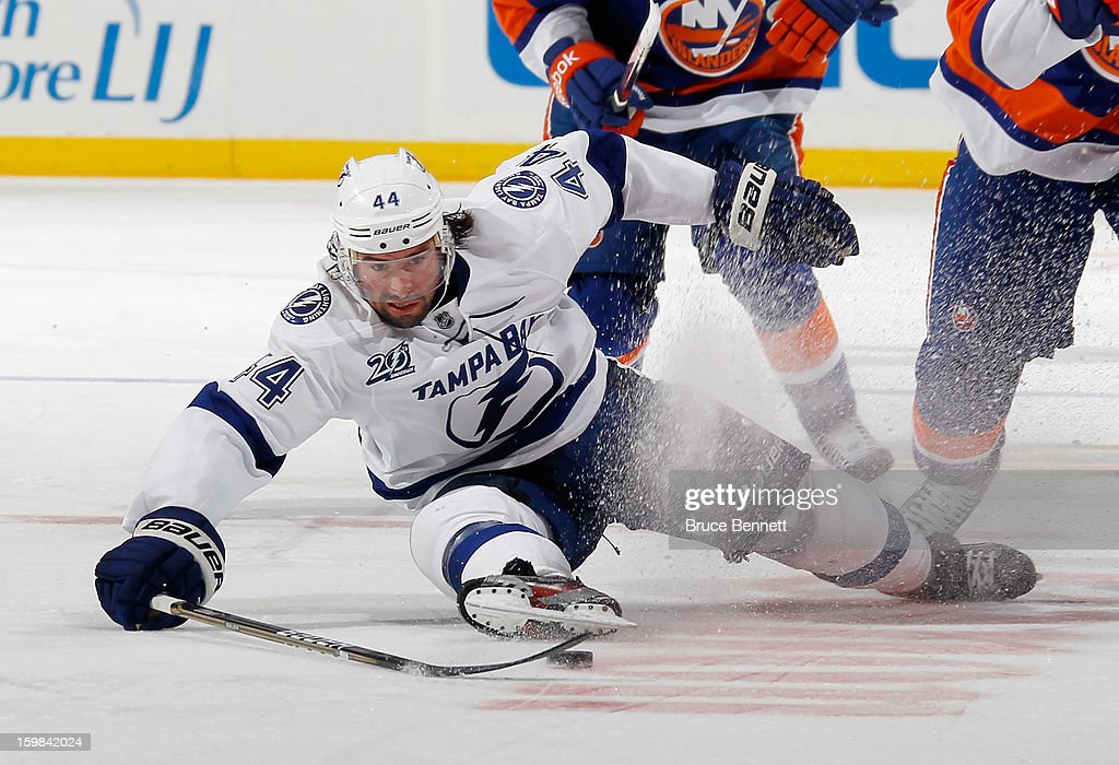 Nate Thompson #44 of the Tampa Bay Lightning tries to get to the puck in the game against the New York Islanders at the Nassau Veterans Memorial Coliseum on January 21, 2013 in Uniondale, New York. The Islanders defeated the Lightning 4-3.